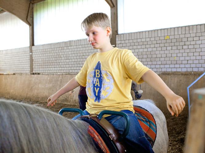 Therapie mit Pferden. Der Pferdesport für Kinder.